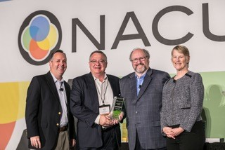 CEO Mike Joplin accepted the New CUSO of the Year Award on behalf of CU Revest,
