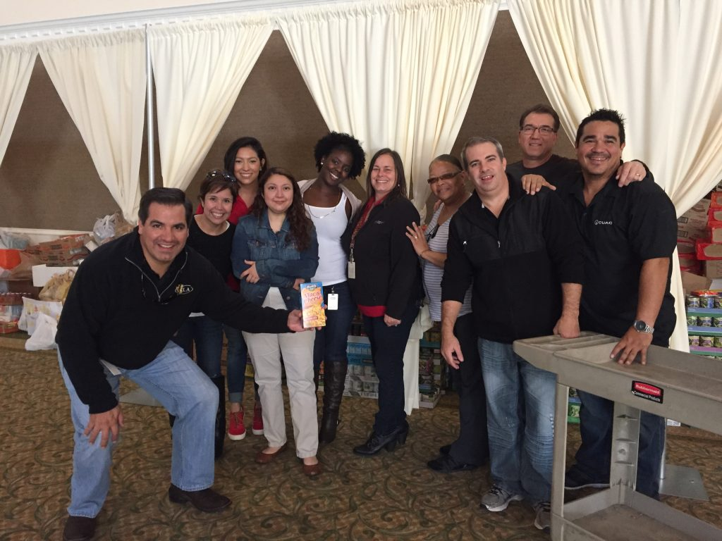 Adrian Dominguez (far left) with CU Alliance staff at the CY-Hope Food Drive